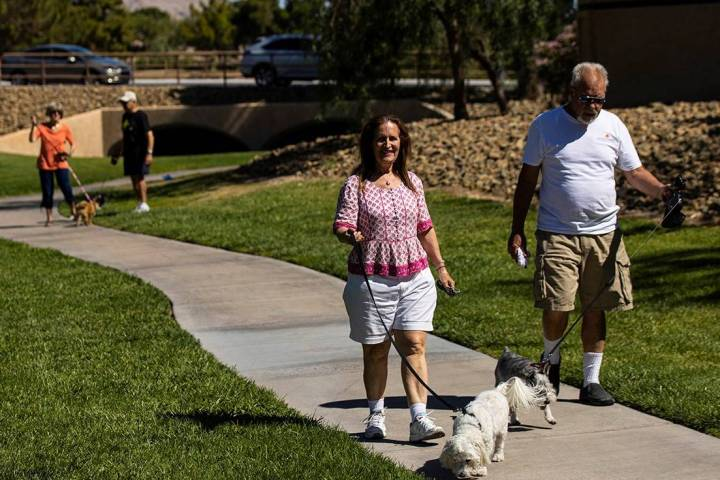 Alexandra Fujioka walks her dog, Dr. Watson, alongside a man who declined to give his name in S ...