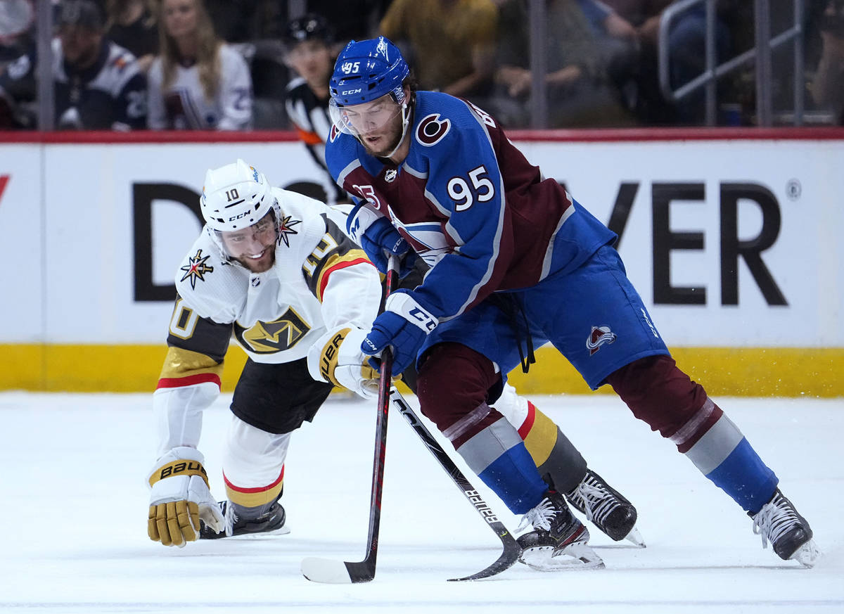 Colorado Avalanche left wing Andre Burakovsky (95) moves the puck against Vegas Golden Knights ...