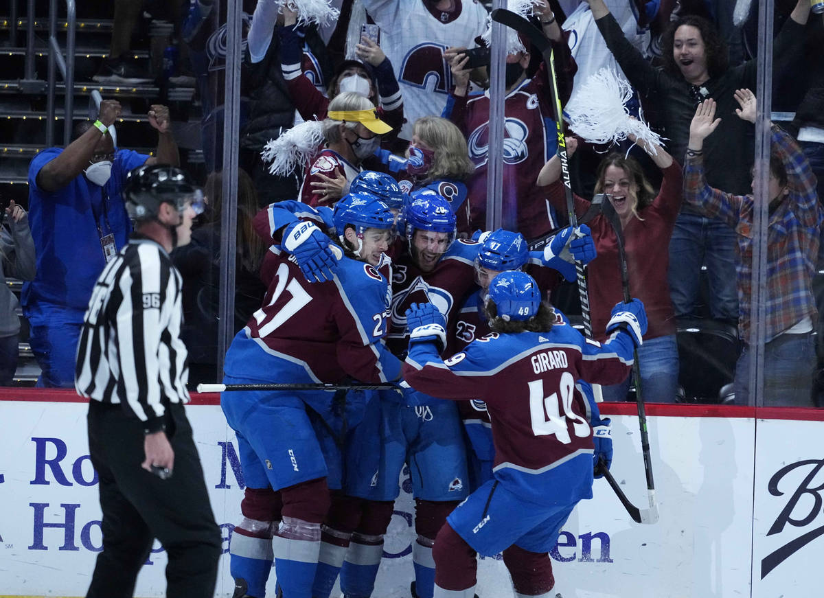 Colorado Avalanche left wing Brandon Saad (20) is congratulated by teammates after his goal aga ...