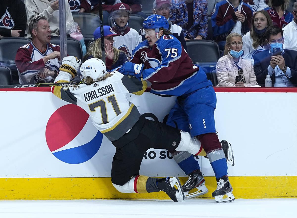 Colorado Avalanche goaltender Justus Annunen (75) knocks Vegas Golden Knights center William Ka ...