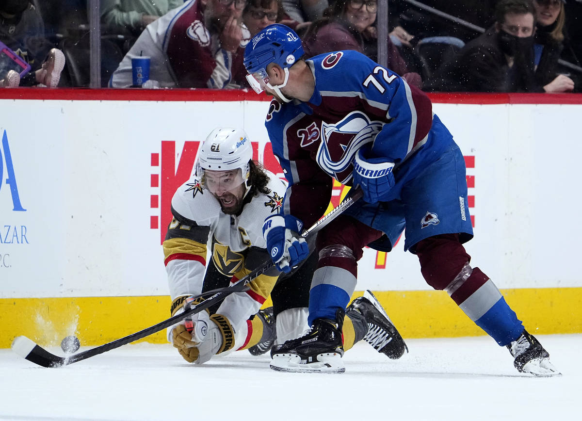 Vegas Golden Knights right wing Mark Stone (61) dives to get the puck from Colorado Avalanche r ...