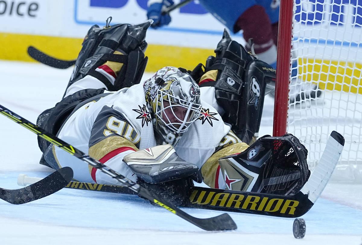 Vegas Golden Knights goaltender Robin Lehner (90) dives for a puck against the Colorado Avalanc ...