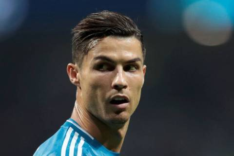Juventus' Cristiano Ronaldo looks back during a Champions League Group D soccer match in Madrid ...
