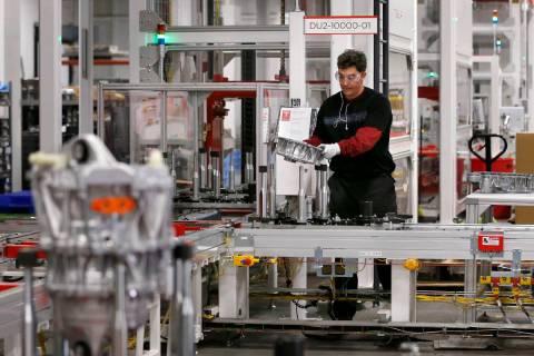 Teakgro Ventra assembles a drive unit at the Tesla Gigafactory, east of Reno. (Cathleen Allison ...