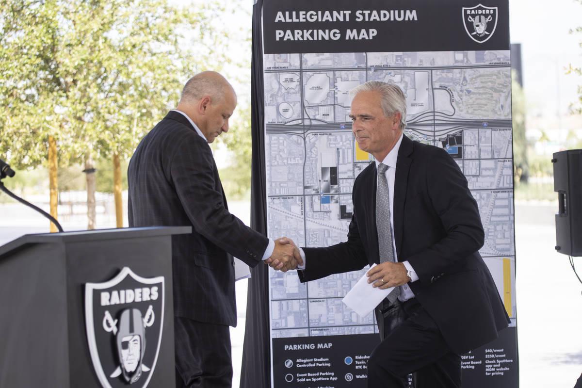 Las Vegas Raiders President Marc Badain, left, introduces Mandalay Bay hotel-casino President a ...