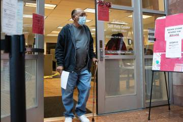In this Oct. 19, 2020, file photo, Jimmy Marks, who received an eviction notice, leaves the Civ ...