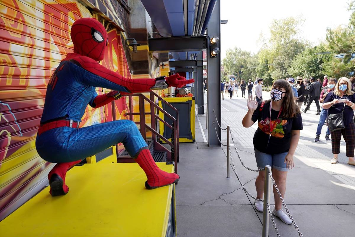 """A Spider-Man character poses for guests following """"The Amazing Spider-Man!"""" show at the Avenger ..."""