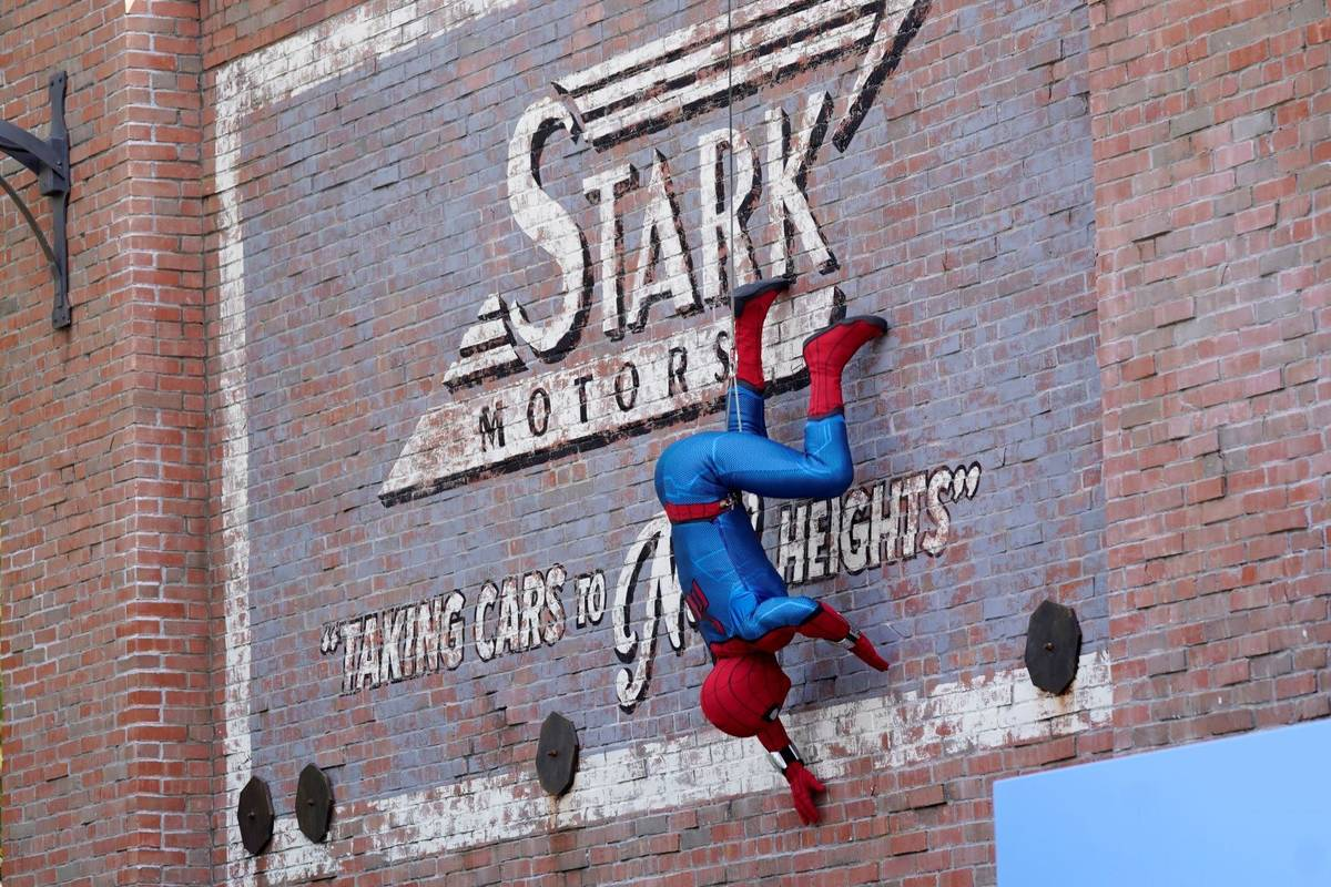 """A Spider-Man character performs during """"The Amazing Spider-Man!"""" show at the Avengers Campus me ..."""