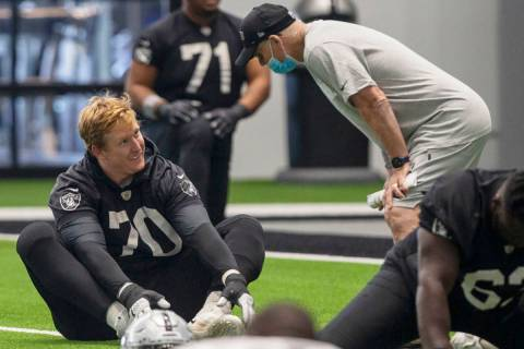 Las Vegas Raiders offensive tackle Sam Young (70) listens to defensive line coach Rod Marinelli ...