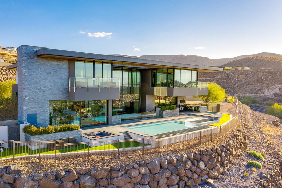 KISS rocker Gene Simmons paid $10.8 million for a modern-style home in the Henderson hillside l ...