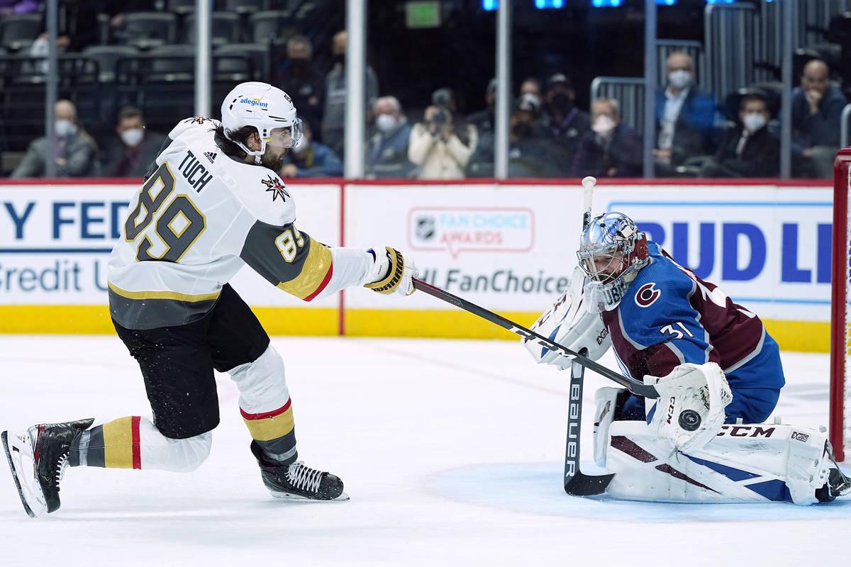 Colorado Avalanche goaltender Philipp Grubauer (31) blocks a shot by Vegas Golden Knights right ...