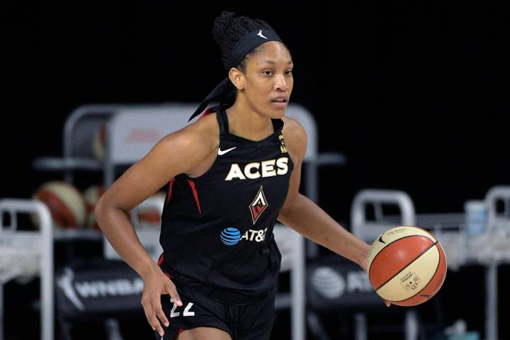 Las Vegas Aces center A'ja Wilson (22) brings the ball up the court during the first half of Ga ...