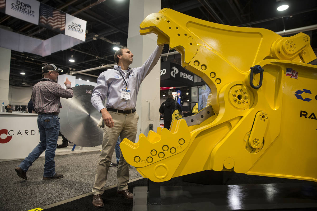 Jon Fodor, with Genesis Attachments, looks over a Genesis Razer heavy electric breaker during d ...