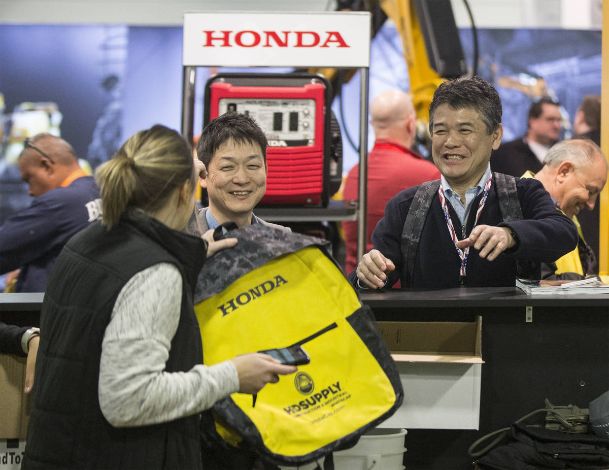 Tom Akahane, right, with Fister, picks up a complimentary HD Supply backpack during the last da ...