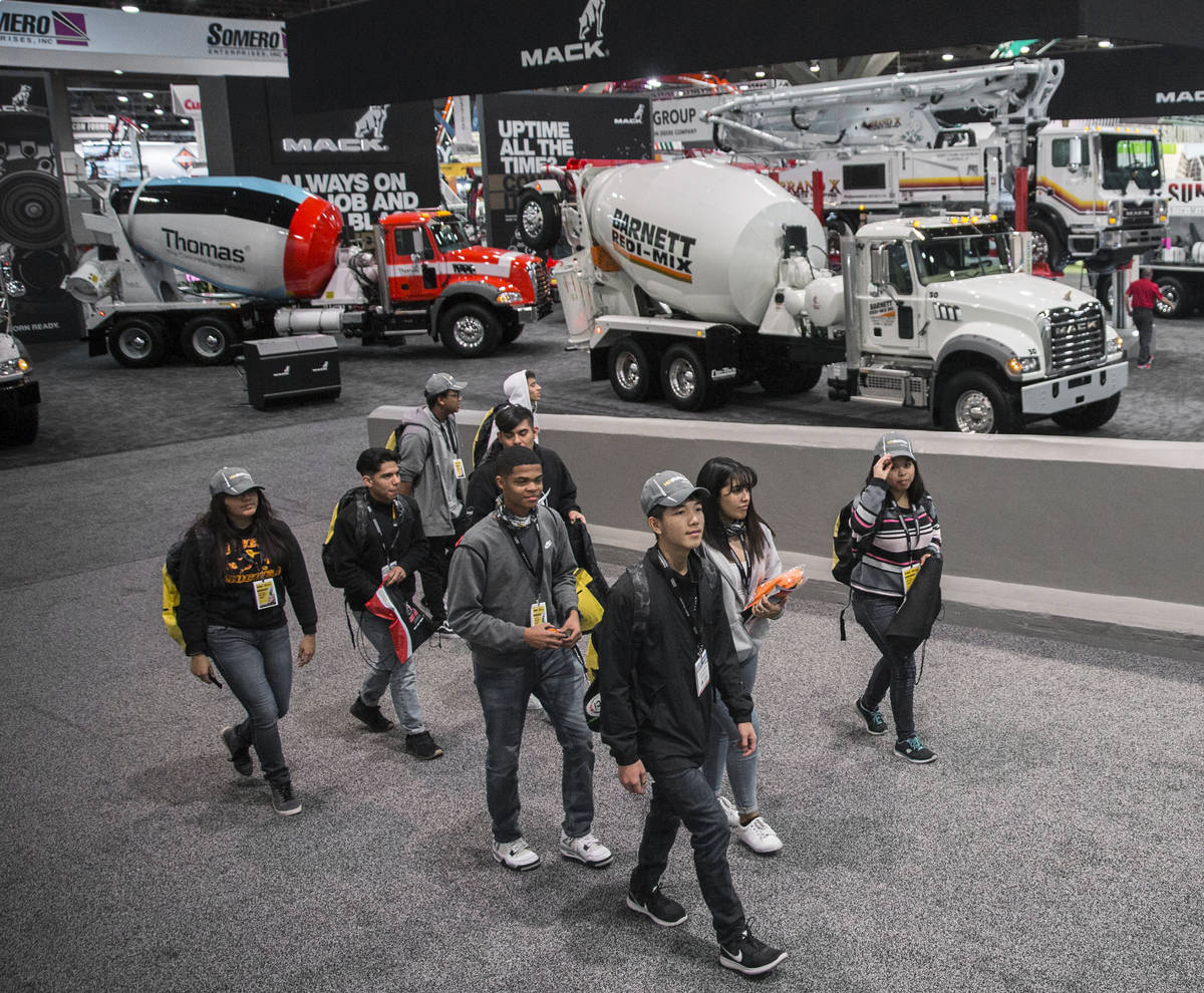 Convention goers explore the Central Hall during the last day of World of Concrete on Friday, J ...