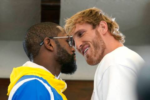 Floyd Mayweather, left, and and Logan Paul, right, face off during a press event, Thursday, Jun ...