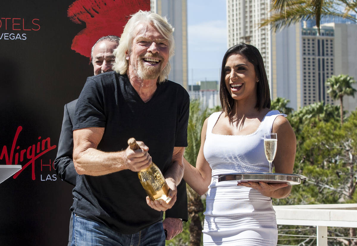Virgin Group Founder Sir Richard Branson prepares for a champagne toast at a press conference a ...