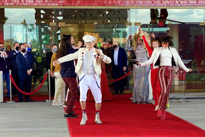 Dancers move up the red carpet and into the venue during the Virgin Hotels Las Vegas opening ce ...
