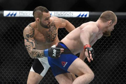 Gunnar Nelson (red gloves) fights Santiago Ponzinibbio (blue gloves) during UFC Fight Night at ...