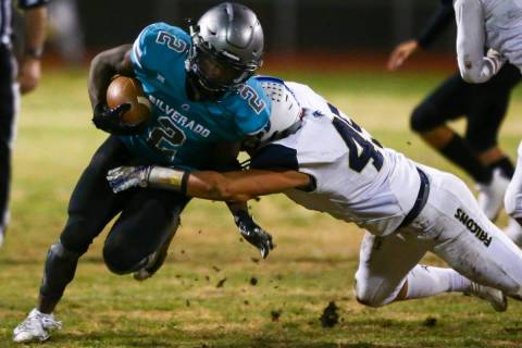 Foothill's Colter Mckee (45) stops Silverado's Aginae Cunningham (2) during the second half of ...