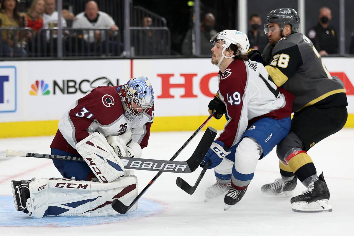 Colorado Avalanche goaltender Philipp Grubauer (31) and defenseman Samuel Girard (49) defend th ...