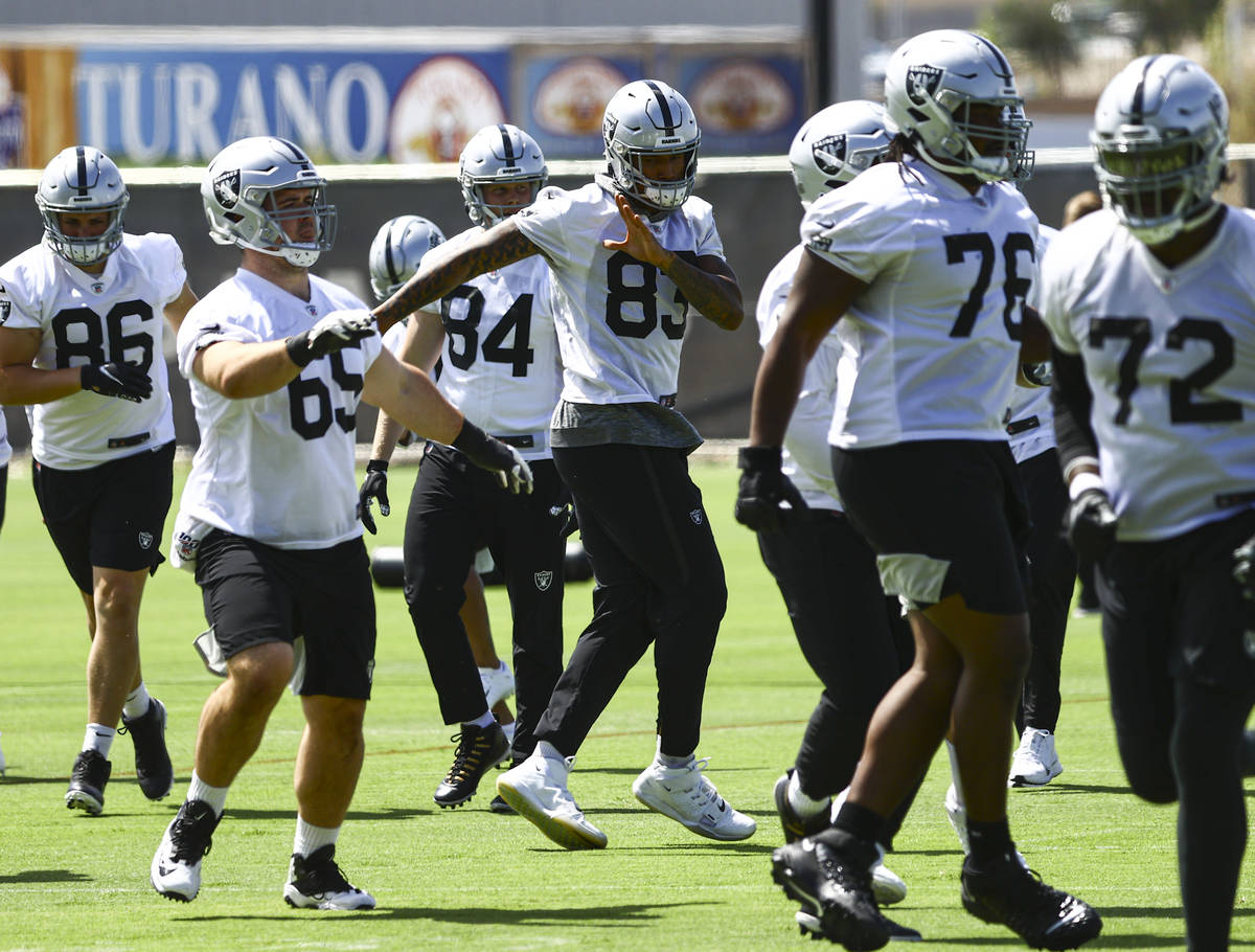 Raiders tight end Darren Waller (83) warms up with teammates during NFL football practice at Ra ...