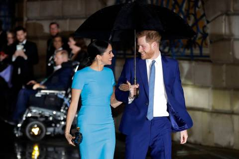 Britain's Prince Harry and Meghan, the Duke and Duchess of Sussex arrive at the annual Endeavou ...