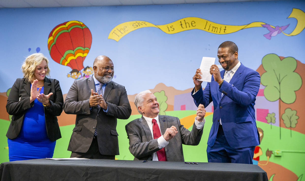 Gov. Steve Sisolak hands previously signed Assembly Bill 495 to President of the Nevada Mining ...
