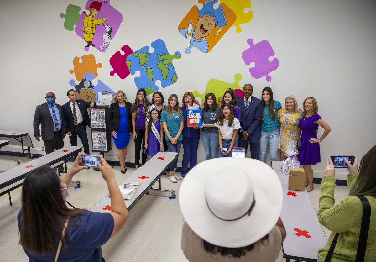Attendees gather for a photo during a ceremony for four bill signings at Fay Herron Elementary ...