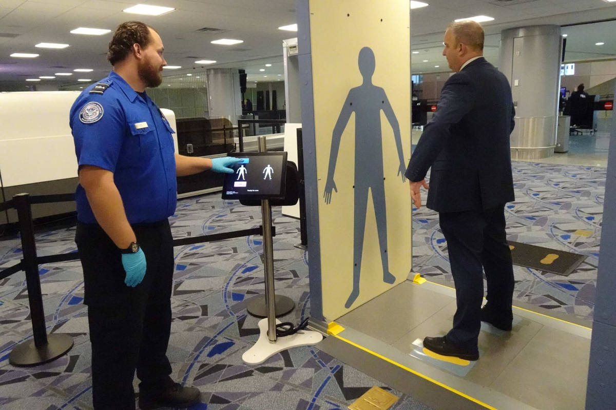 A Transportation Security Administration officer demonstrates new security technology at McCarr ...