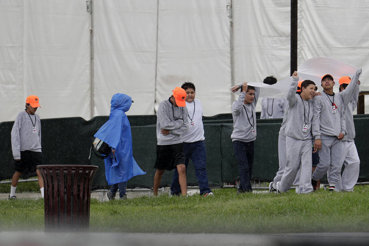 Migrant children walk on the grounds of the Homestead Temporary Shelter for Unaccompanied Child ...
