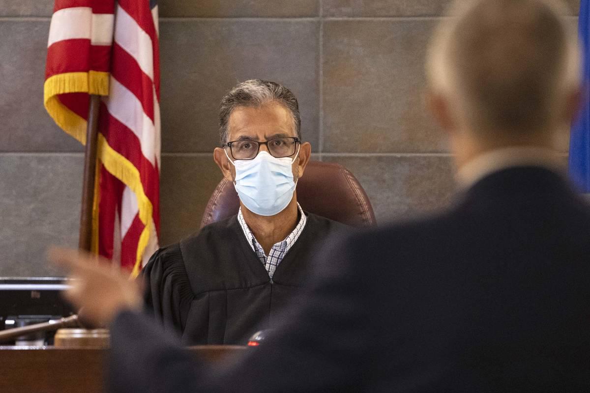 District Judge Michael Villani listens as defense attorney David Anthony, representing Zane Flo ...