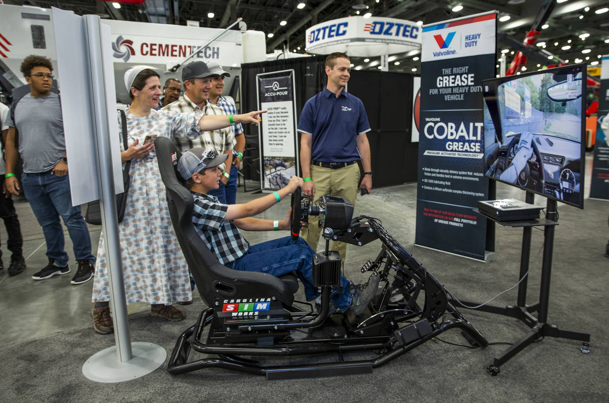 Suzanne, Vern and Wade Zook, 17, from left, enjoy watching Wyatt Zook, 12, drive a racing car s ...