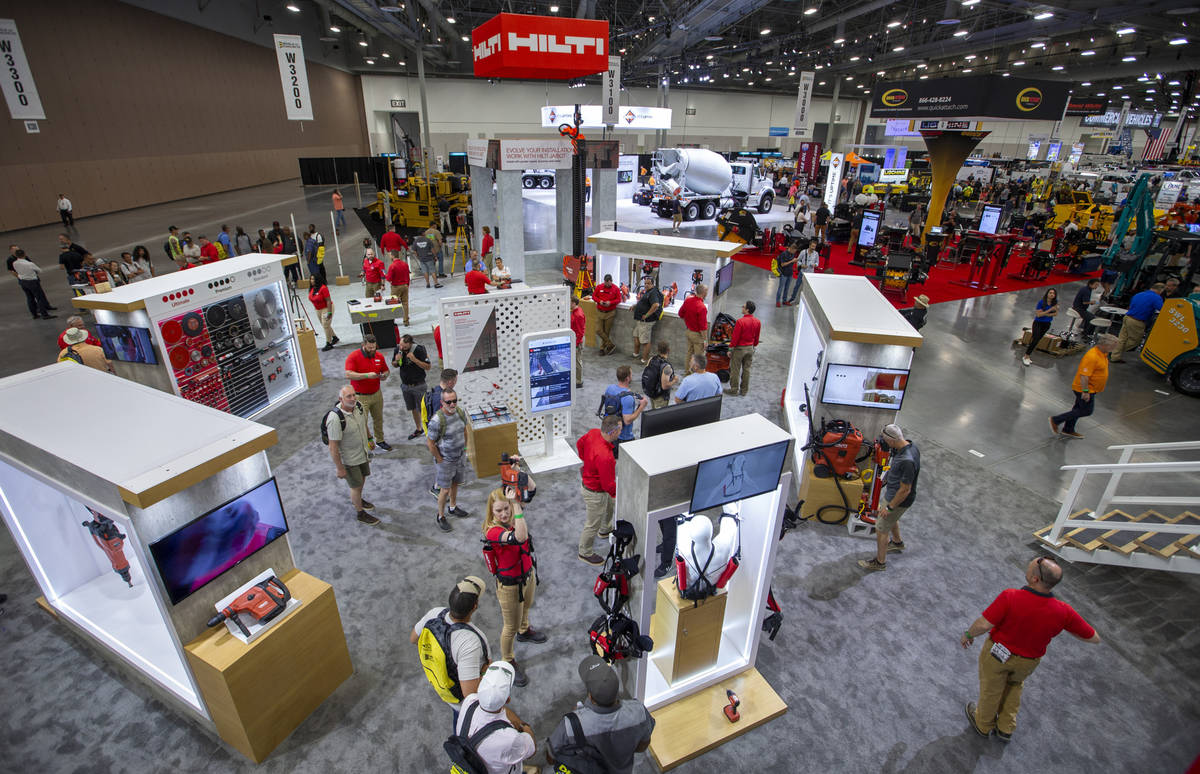 World of Concrete 2021 attendees check out some of the products offered by Hilti representative ...