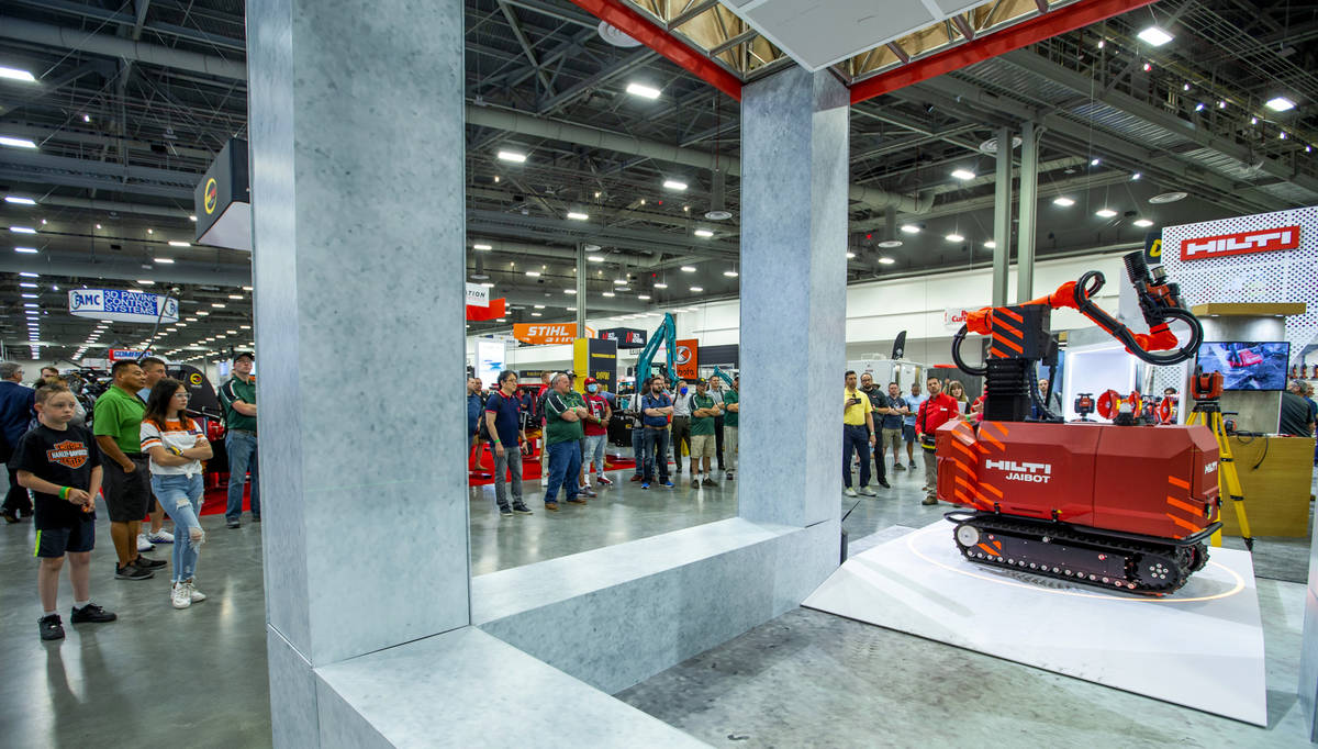 World of Concrete 2021 attendees watch a demonstration of the Hilti Jaibot construction robot a ...