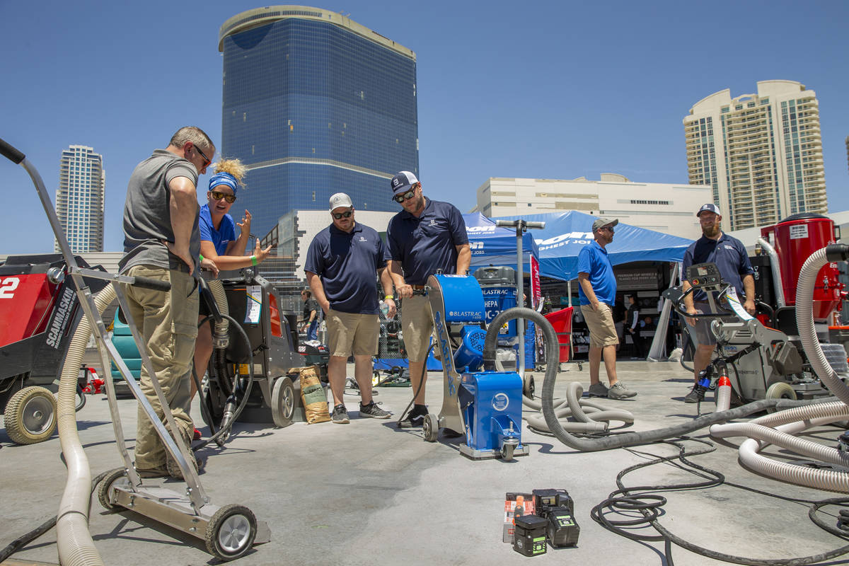 A Blastrac surface preparation machine is demonstrated at the Jon-Don display outside of the We ...