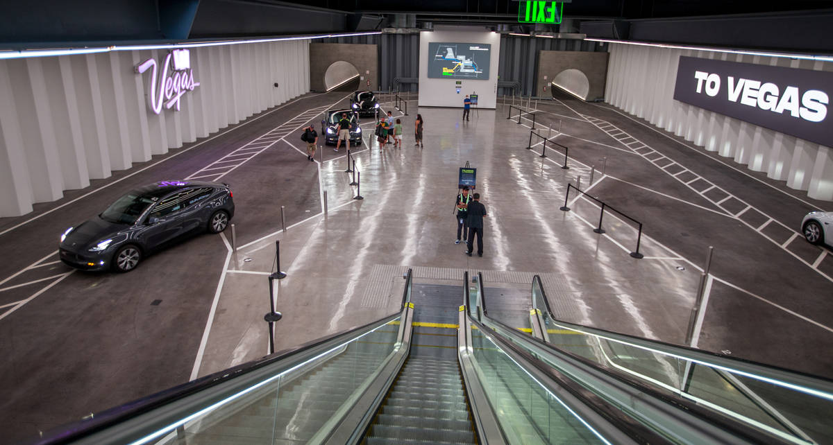 Teslas arrive and depart the Central Hall stop in the Boring Company's Convention Center Loop W ...