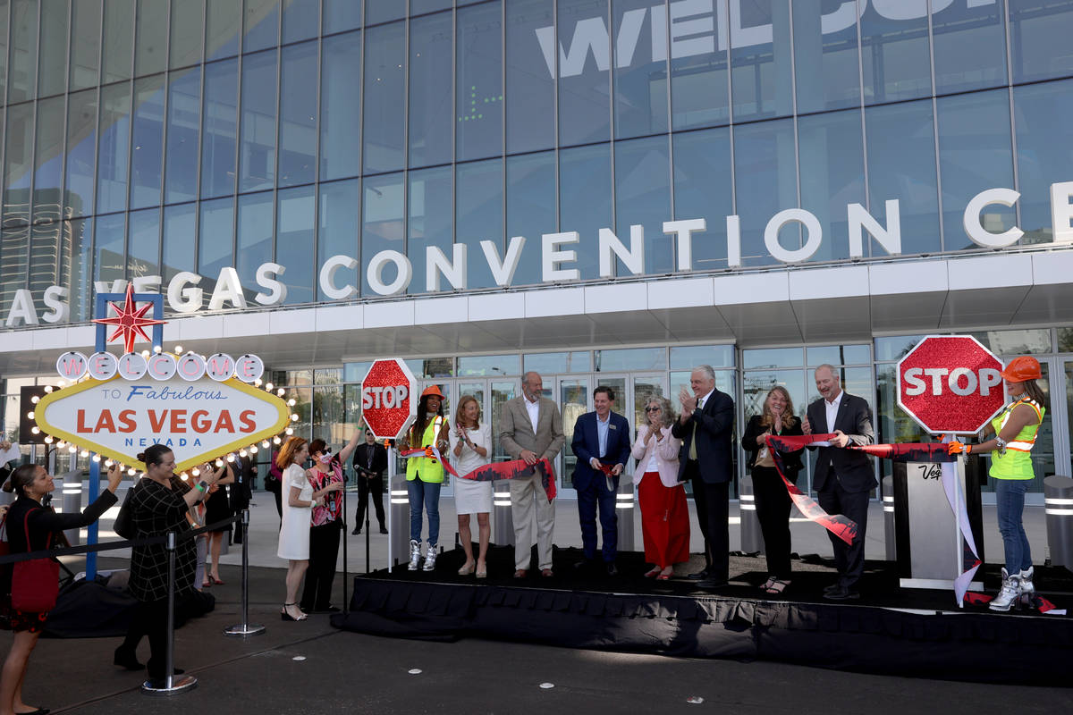 Dignitaries and government officials cut the ribbon to open the Las Vegas Convention Center's n ...