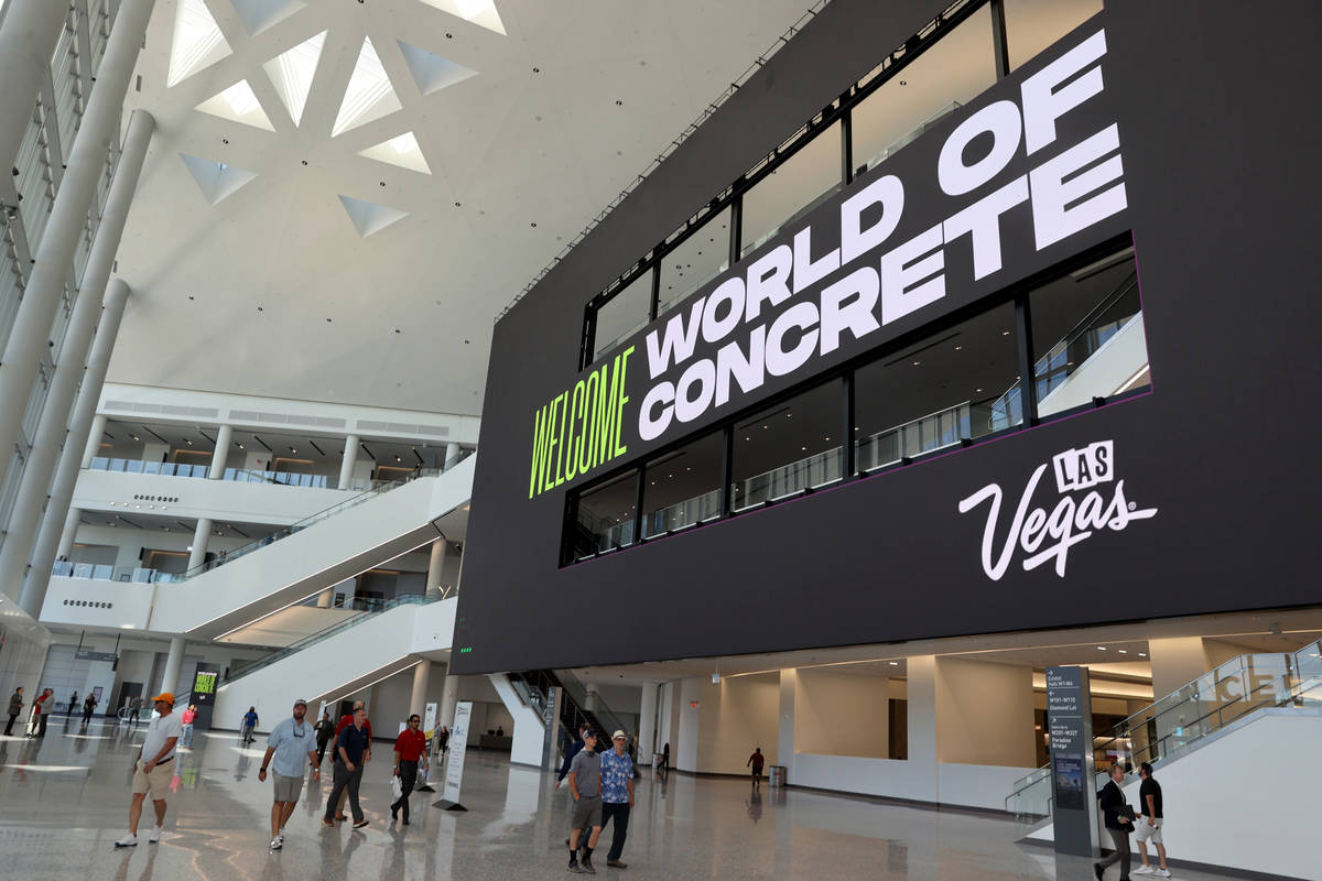 Conventioneers at the World of Concrete trade show in the main lobby at the Las Vegas Conventio ...