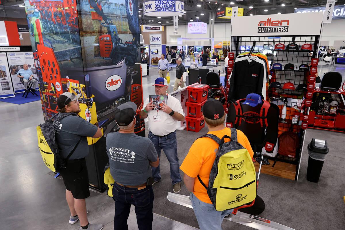 Allen Engineering Sales Representative Tim Duty talks to Jared Knight, from left, Ken Knight an ...