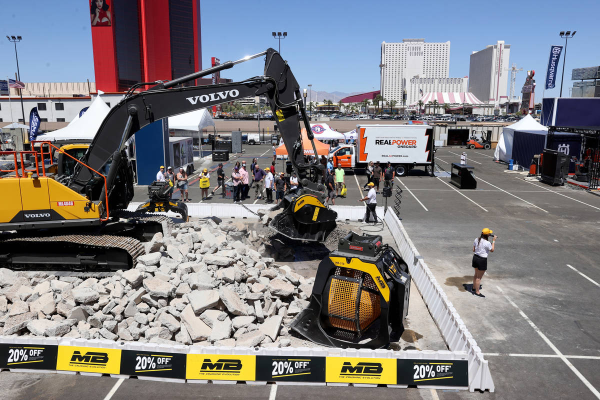 Conventioneers check out the MB Crusher America booth at the World of Concrete trade show outsi ...