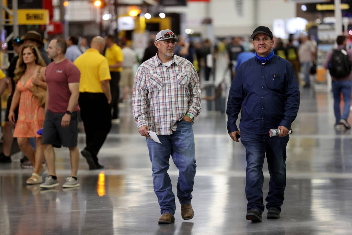 Conventioneers Matt Sierras, left, and Max Soto of Tucson, Ariz. walk the show floor at the Wor ...