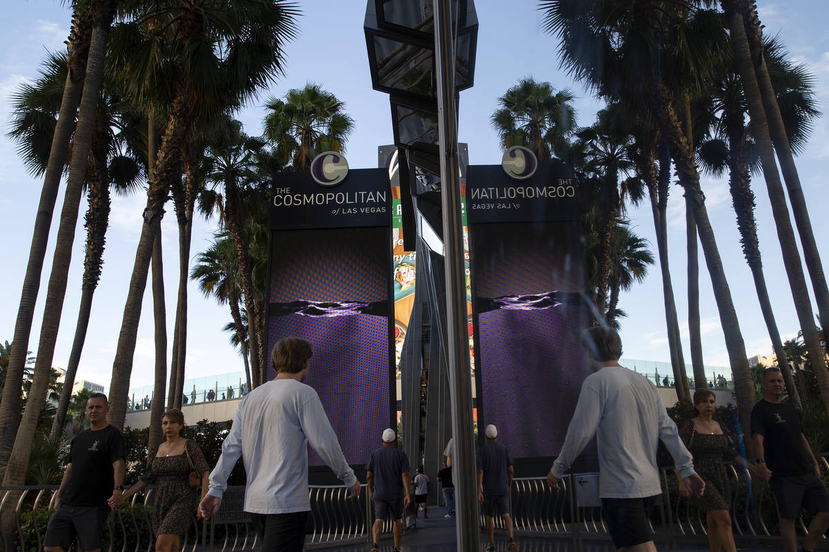 Pedestrians pass Cosmopolitan of Las Vegas on Wednesday, June 9, 2021 in Las Vegas. The Las Veg ...