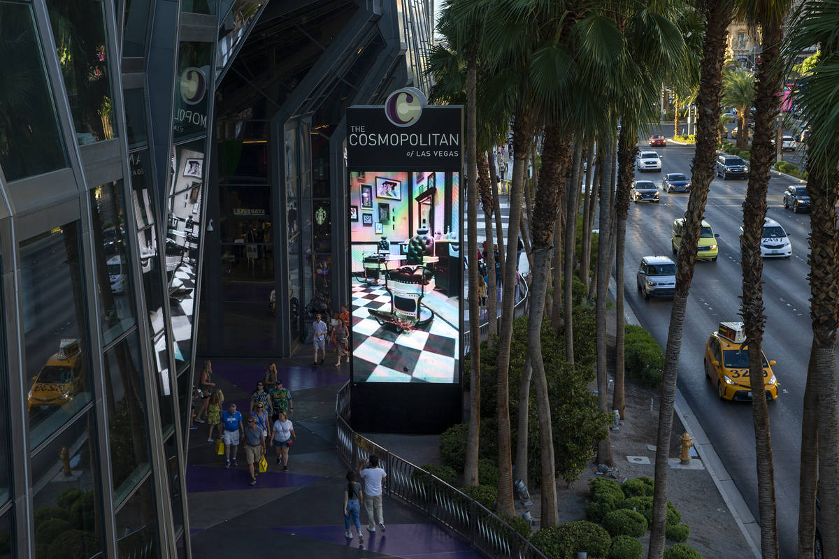 Pedestrians and traffic pass Cosmopolitan of Las Vegas on Wednesday, June 9, 2021 in Las Vegas. ...