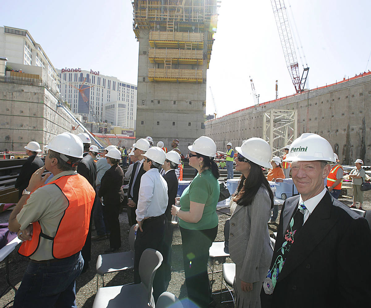 New York developer Ian Bruse Eichner, right, stands with other VIP guests and construction work ...
