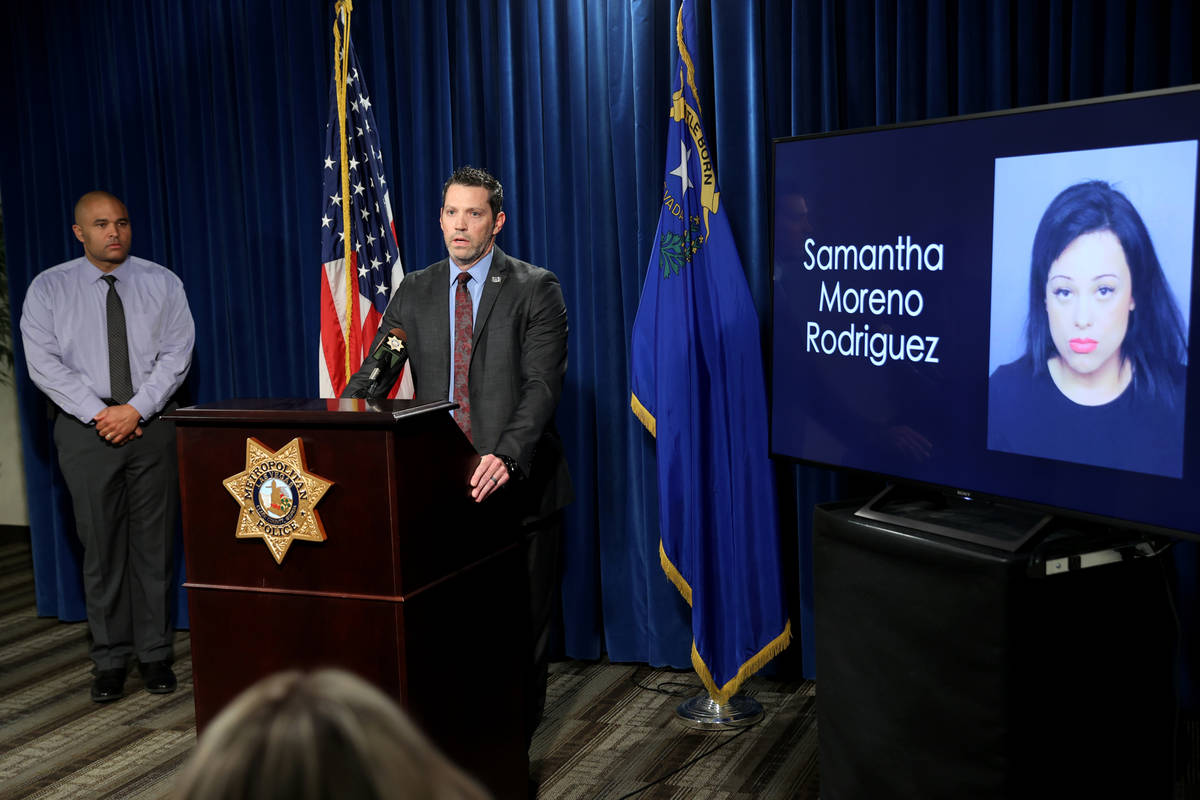 Jeremy Schwartz, FBI supervisory special agent, right and Las Vegas police Las Vegas police hom ...
