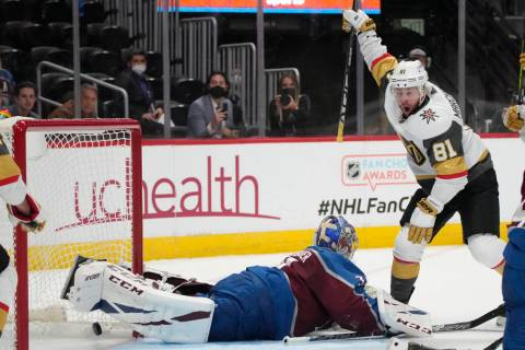 Vegas Golden Knights center Jonathan Marchessault, right, reacts after soring a goal past Color ...