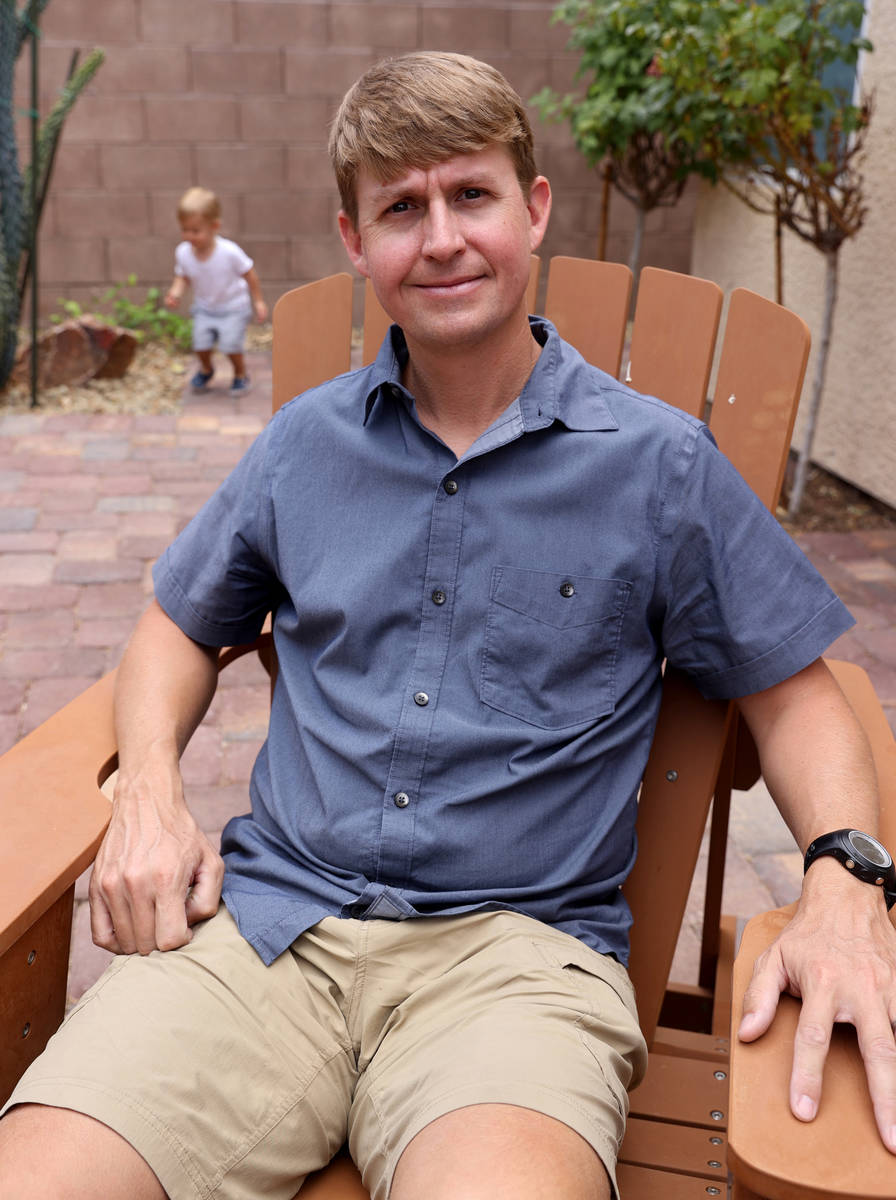 Shane Peterson with his son, Henry, 21 months, at his Henderson home on June 9, 2021. Peterson ...