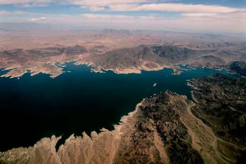 Lake Mead, which separates Arizona, bottom, and Nevada, top, is seen from the air, east of Las ...