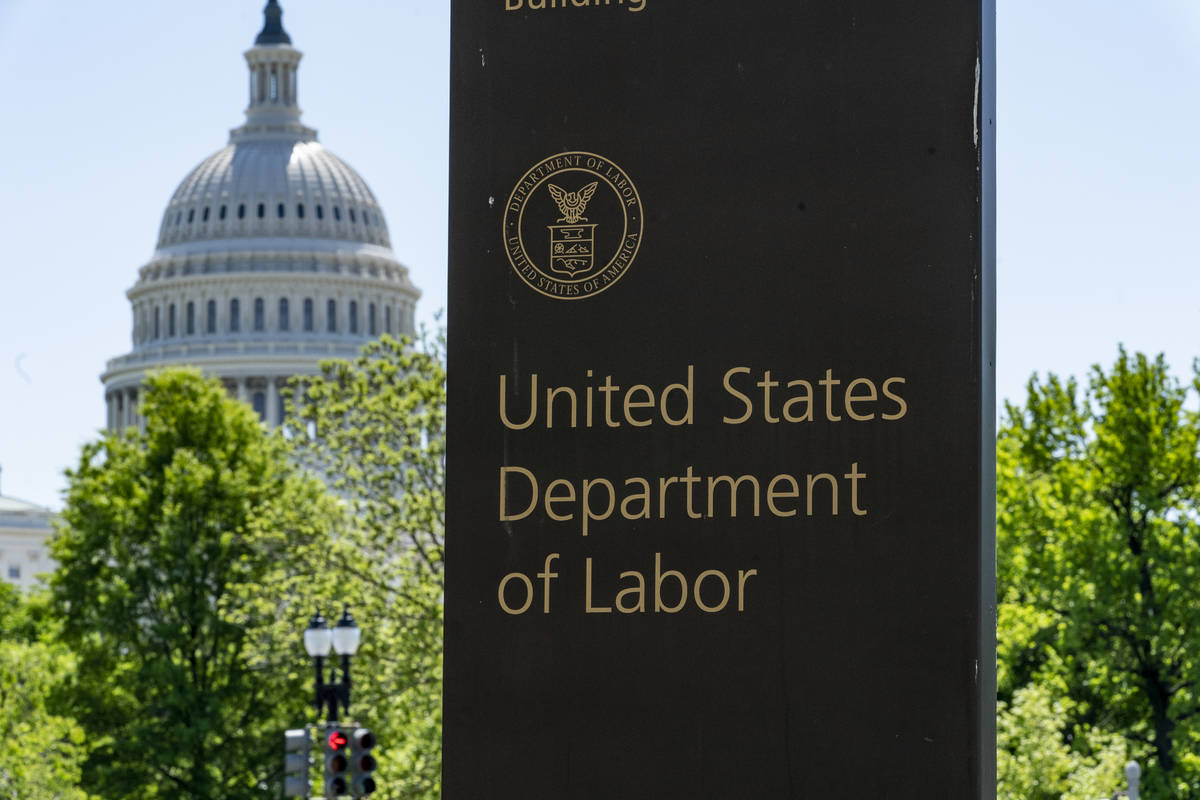 In this May 7, 2020, file photo, the entrance to the Labor Department is seen near the Capitol ...